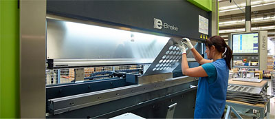 Employee with handgloves working in ETAP production